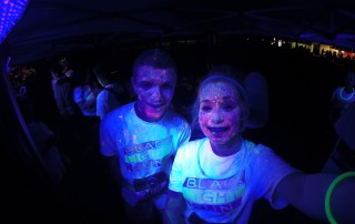 Glow powder on our skin and shirt